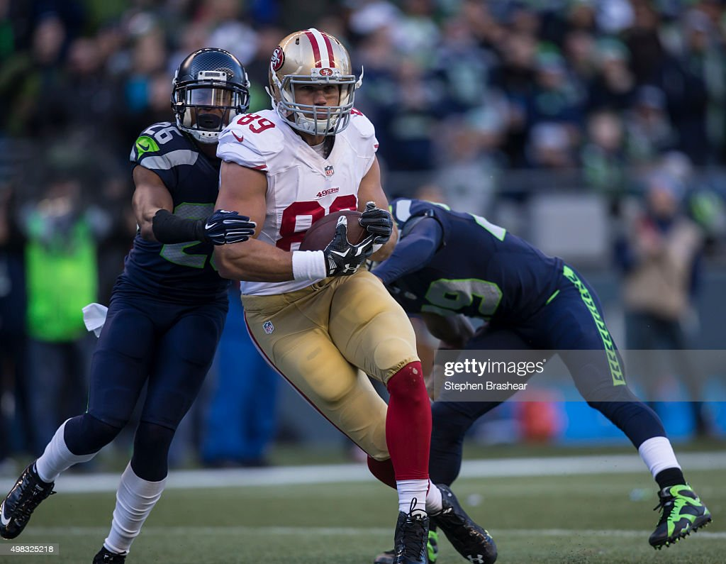 Tight end <a gi-track='captionPersonalityLinkClicked' href=/galleries/search?phrase=Vance+McDonald&family=editorial&specificpeople=7179764 ng-click='$event.stopPropagation()'>Vance McDonald</a> #89 of the San Francisco 49ers drags defensive back <a gi-track='captionPersonalityLinkClicked' href=/galleries/search?phrase=Cary+Williams+-+American+Football+Player&family=editorial&specificpeople=10178470 ng-click='$event.stopPropagation()'>Cary Williams</a> #26 of the Seattle Seahawks after to making a reception to score a touchdown during the first half of a football game at CenturyLink Field on November 22, 2015 in Seattle, Washington