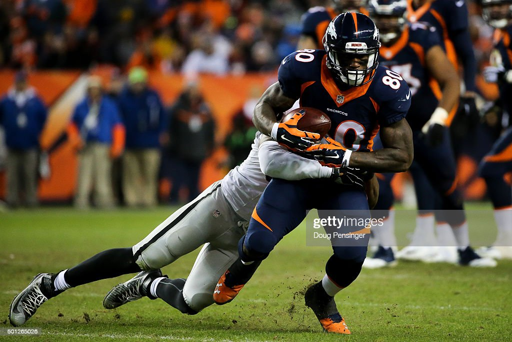 Tight end Vernon Davis of the Denver Broncos is tackled after a catch by outside linebacker Malcolm Smith of the Oakland Raiders at Sports Authority...