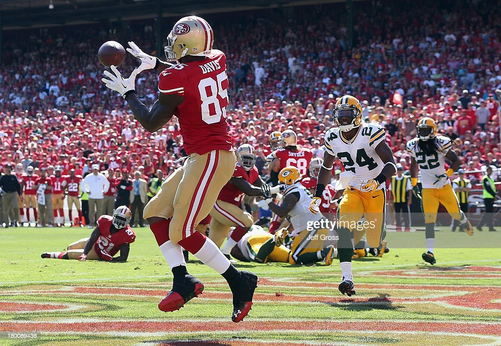 Tight end <a gi-track='captionPersonalityLinkClicked' href=/galleries/search?phrase=Vernon+Davis&family=editorial&specificpeople=592553 ng-click='$event.stopPropagation()'>Vernon Davis</a> #85 of the San Francisco 49ers catches a pass for a touchdown, as <a gi-track='captionPersonalityLinkClicked' href=/galleries/search?phrase=Jarrett+Bush&family=editorial&specificpeople=772499 ng-click='$event.stopPropagation()'>Jarrett Bush</a> #24 of the Green Bay Packers pursues in the third quarter at Candlestick Park on September 8, 2013 in San Francisco, California. The 49ers defeated the Packers 34-28.