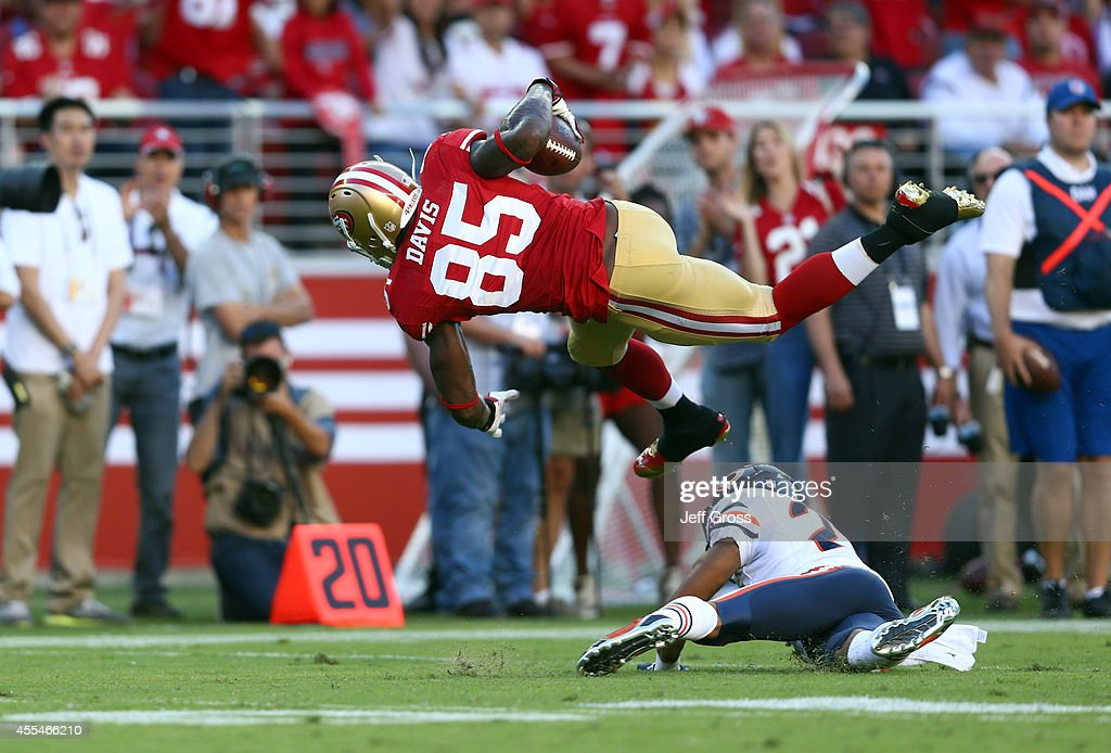 Tight end Vernon Davis of the San Francisco 49ers gets hit by cornerback Kyle Fuller of the Chicago Bears during the second quarter of their game at...