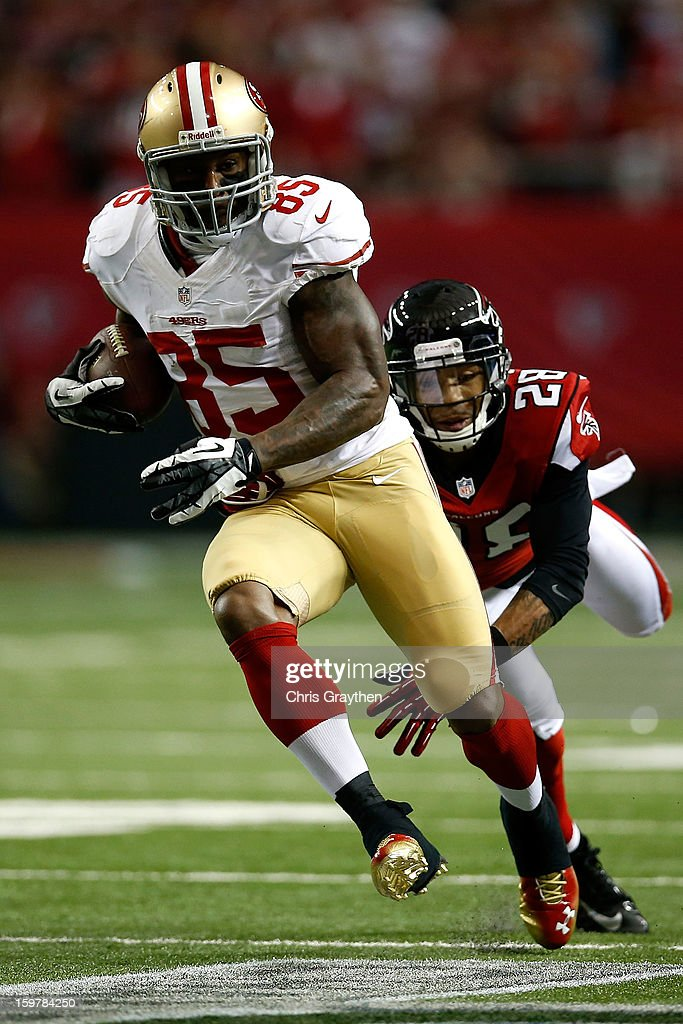 Tight end Vernon Davis #85 of the San Francisco 49ers runs after a catch in front of free safety Thomas DeCoud #28 of the Atlanta Falcons in the second quarter in the NFC Championship game at the Georgia Dome on January 20, 2013 in Atlanta, Georgia.