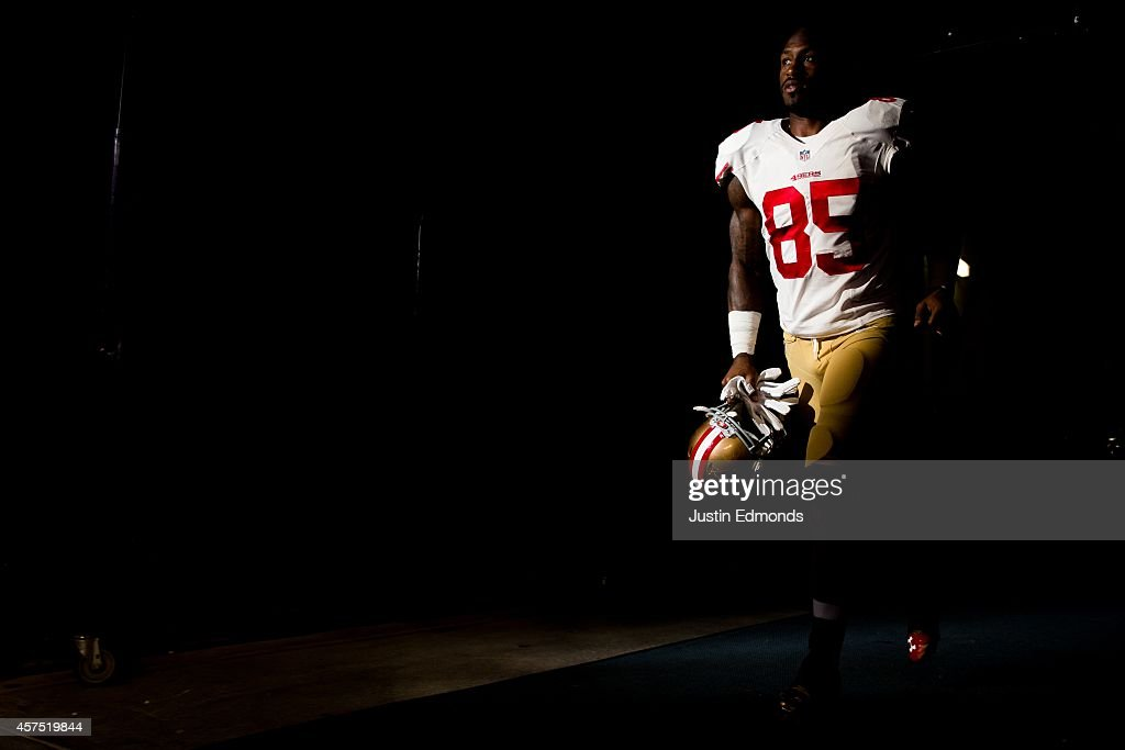 Tight end Vernon Davis of the San Francisco 49ers walks in the tunnel before coming out onto the field to play the Denver Broncos at Sports Authority...