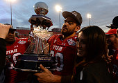 Tight end Westlee Tonga of the Utah Utes carries the trophy after the team defeated the Colorado State Rams 4510 in the Royal Purple Las Vegas Bowl...