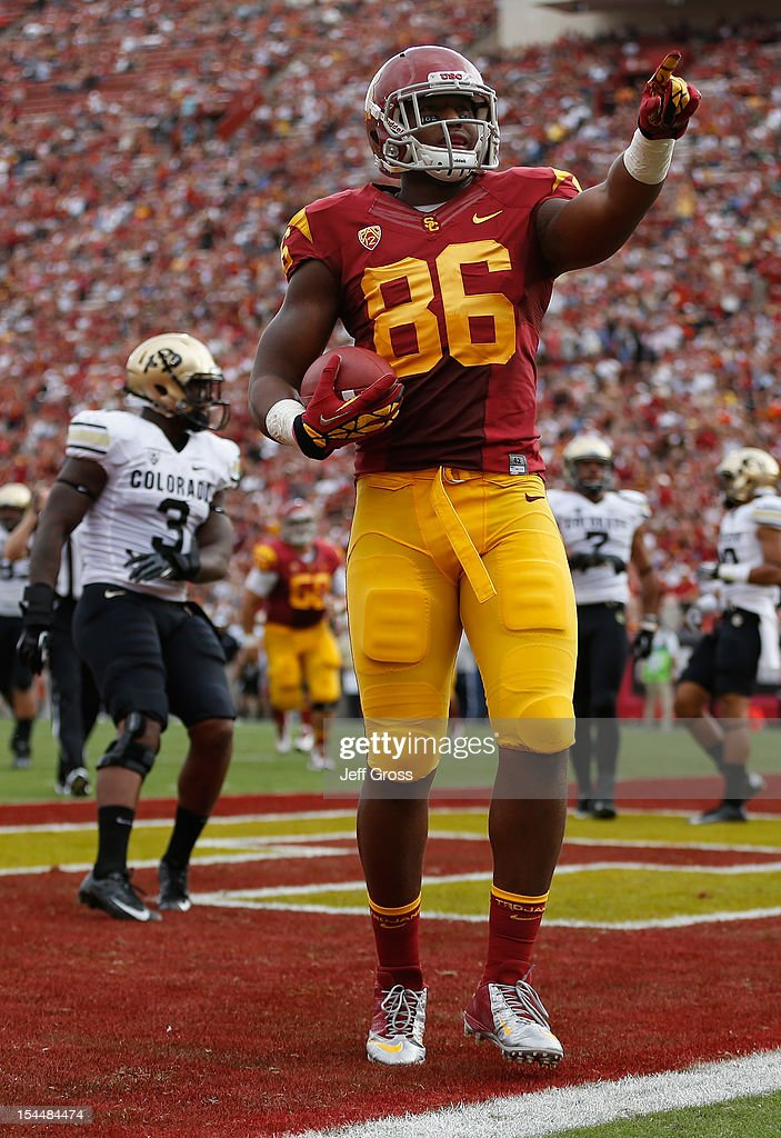 Tight end Xavier Grimble #86 of the USC Trojans celebrates a touchdown in the first quarter against the Colorado Buffaloes at Los Angeles Memorial Coliseum on October 20, 2012 in Los Angeles, California. USC defeated Colorado 50-6.