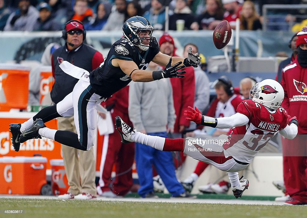Tight end Zach Ertz of the Philadelphia Eagles dives unsuccessfully to make a catch as safety Tyrann Mathieu of the Arizona Cardinals looses his...