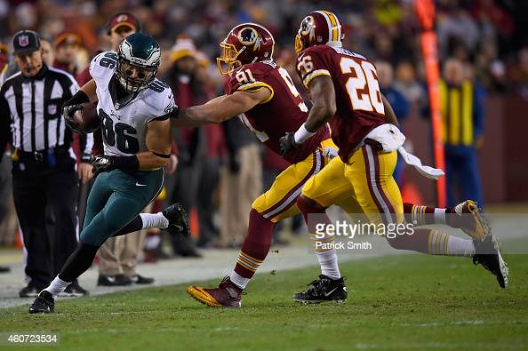 Tight end Zach Ertz of the Philadelphia Eagles is forced out of bounds by outside linebacker Ryan Kerrigan of the Washington Redskins in the first...