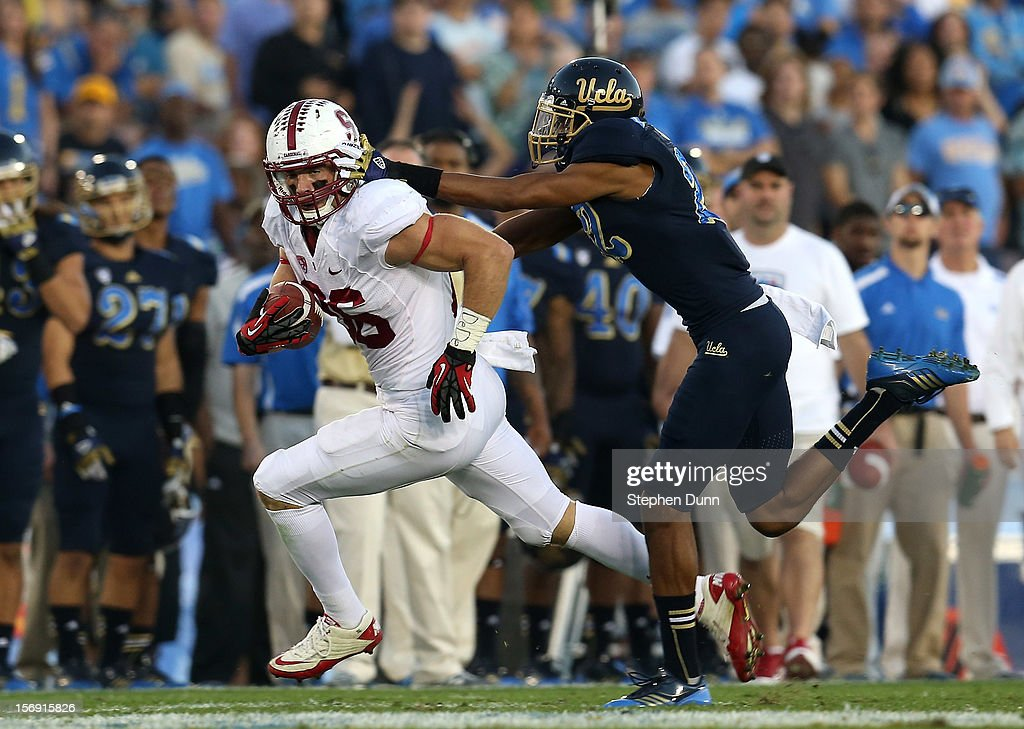 Tight end Zach Ertz #86 of the Stanford Cardinal carries the ball after a catch against cornerback Sheldon Price #22 of the UCLA Bruins at the Rose Bowl on October 13, 2012 in Pasadena, California. Stanford won 35-17.