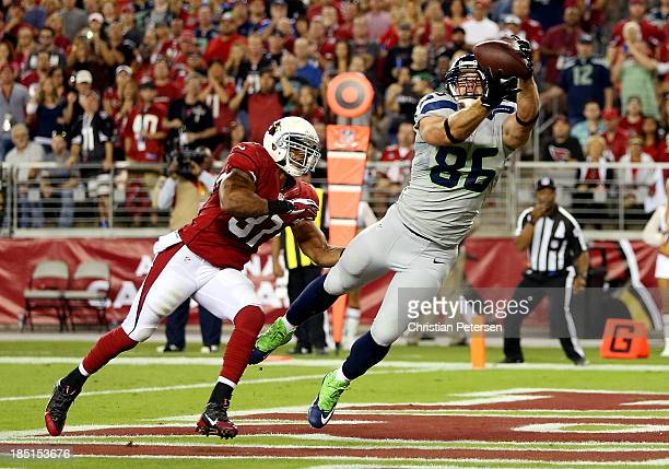 Tight end Zach Miller of the Seattle Seahawks catches a touchdown against the Arizona Cardinals in the second quarter during a game at the University...