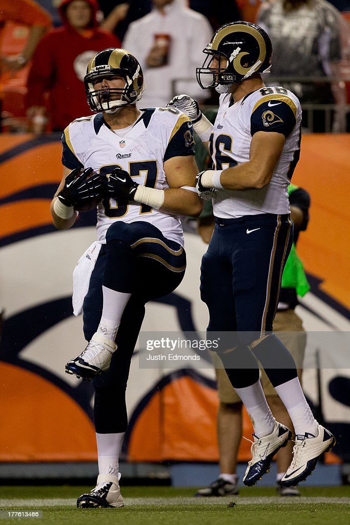 Tight end Zach Potter #87 of the St. Louis Rams celebrates his fourth quarter touchdown against the Denver Broncos with teammate tight end Colby Prince #86 at Sports Authority Field Field at Mile High on August 24, 2013 in Denver, Colorado. The Broncos defeated the Rams 27-26.