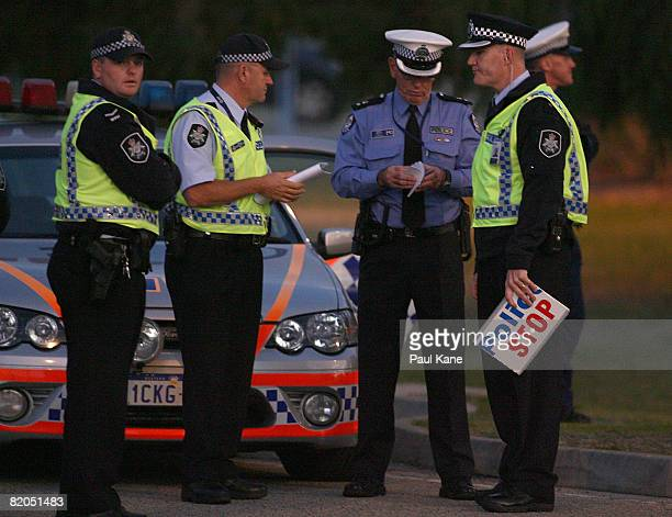 A tight police contingent surrounds the Perth International Airport prior to the arrival of US Secretary of State Dr Condoleezza Rice on 24 July 2008...