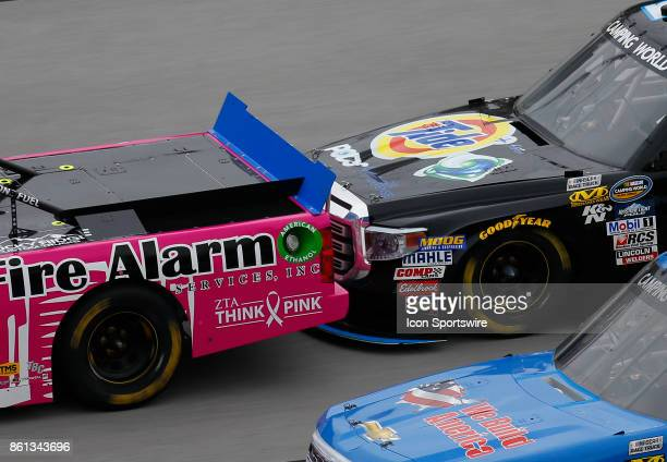 Tight racing action during the Fred's 250 NASCAR Camping World truck race on October 14 at the Talladega Superspeedway in Talladega AL
