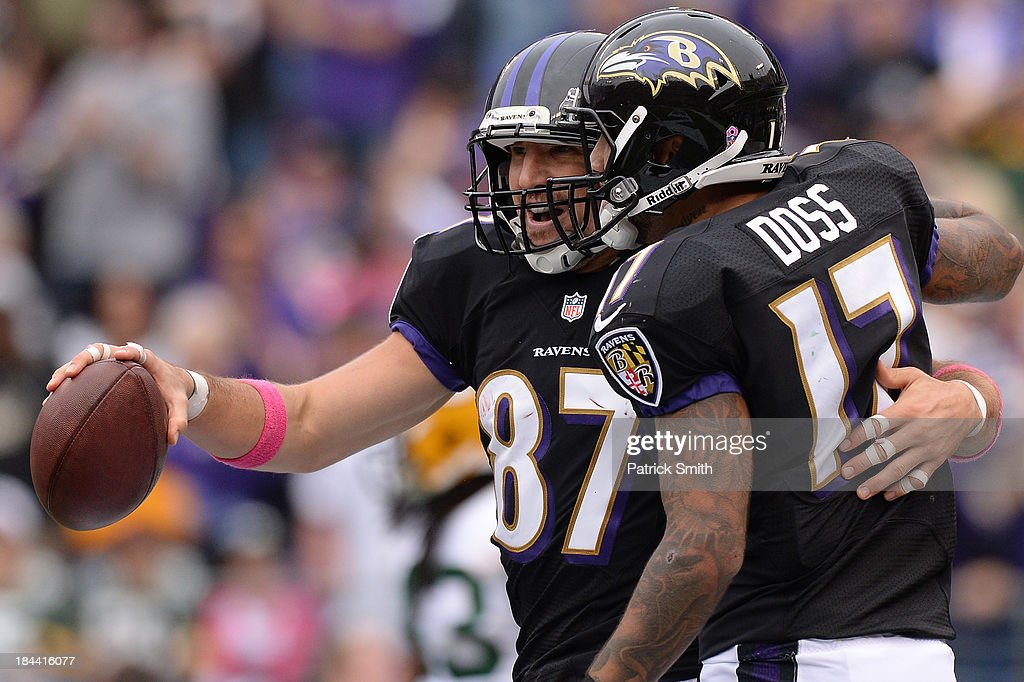tightend <a gi-track='captionPersonalityLinkClicked' href=/galleries/search?phrase=Dallas+Clark&family=editorial&specificpeople=184501 ng-click='$event.stopPropagation()'>Dallas Clark</a> #87 of the Baltimore Ravens celebrates with teammate <a gi-track='captionPersonalityLinkClicked' href=/galleries/search?phrase=Tandon+Doss&family=editorial&specificpeople=5590583 ng-click='$event.stopPropagation()'>Tandon Doss</a> #17 after scoring a touchdown against the Green Bay Packers in the fourth quarter at M&T Bank Stadium on October 13, 2013 in Baltimore, Maryland.