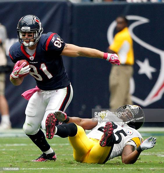 Tightend Owen Daniels of the Houston Texans breaks a tackle by Ryan Clark of the Pittsburgh Steelers at Reliant Stadium on October 2 2011 in Houston...