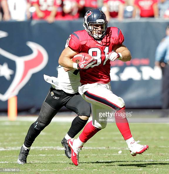 Tightend Owen Daniels of the Houston Texans breaks loose on big gain against the Jacksonville Jaguars at Reliant Stadium on October 30 2011 in...
