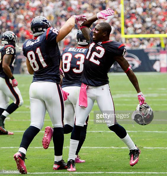 Tightend Owen Daniels of the Houston Texans gets a high five from Jacoby Jones after he scored in the first quarter against the Pittsburgh Steelers...
