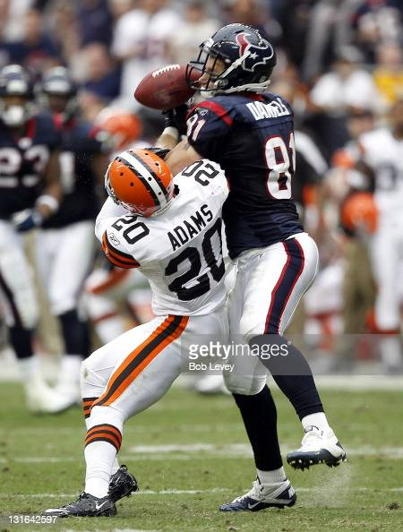 Tightend Owen Daniels of the Houston Texans has the ball knocked out of hands by defensive back Mike Adams of the Cleveland Browns in the second...