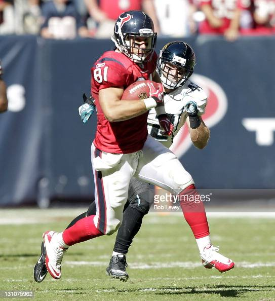 Tightend Owen Daniels of the Houston Texans runs with the ball past Chris Prosinski of the Jacksonville Jaguars after making a reception> at Reliant...