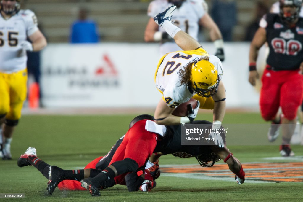 Tightend Tim Erjavec #42 of the Kent State Golden Flashes leaps over a Arkansas State player on January 6, 2013 at Ladd-Peebles Stadium in Mobile, Alabama. Arkansas State defeated Kent State 17-13.