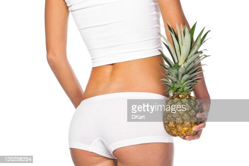 tightened woman's buttocks in white linen with pineapple : Stock Photo