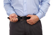 Businessman tightening his belt concept for recession or economic depression