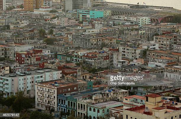 Tightly packed residential buildings in varying states of repair and disrepair stand in the Vedado neighborhood near the historic Malecon oceanfront...