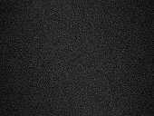 A tightly woven carbon fiber background illustration.
