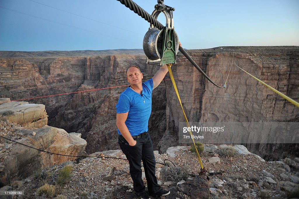Tightrope walker <a gi-track='captionPersonalityLinkClicked' href=/galleries/search?phrase=Nik+Wallenda&family=editorial&specificpeople=7696638 ng-click='$event.stopPropagation()'>Nik Wallenda</a> looks at the two-inch cable he'll be walking on as he prepares to walk across the Grand Canyon at the Grand Canyon on June 21, 2013 in Grand Canyon, Arizona.