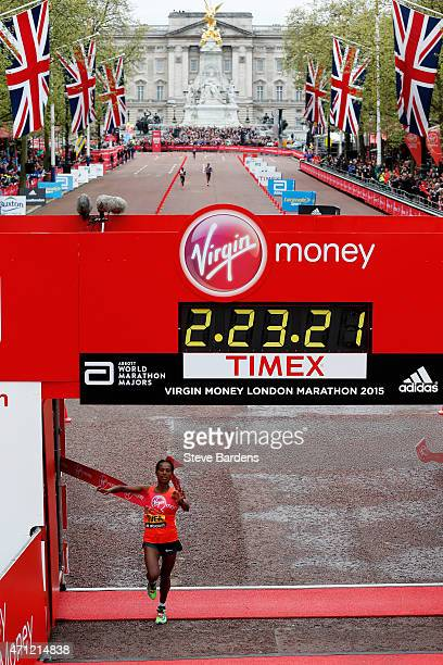 Tigist Tufa of Ethiopia crosses the finish line to win the Women's race during the Virgin Money London Marathon on April 26 2015 in London England