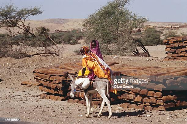 Tigre girls riding on donkey.