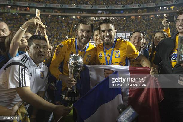 Tigres' Andre Pierre Gignac and Andy Delort celebrate with the trophy after defeating America during their Mexican Apertura 2016 tournament football...