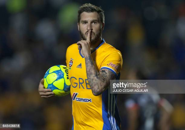 Tigres' Andre Pierre Gignac celebrates after scoring against Morelia during the Mexican Clausura 2017 tournament football match at the Universitario...