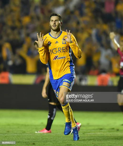 Tigres' Andre Pierre Gignac celebrates after scoring against Pumas during their Mexican Clausura 2017 tournament football match at the Universitario...
