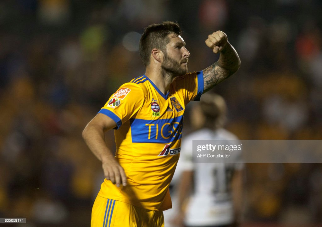 Tigres' Andre Pierre Gignac celebrates after scoring against Pumas during their Mexican Apertura 2017 tournament football match at the Universitario stadium in Monterrey, Mexico on August 19, 2017. / AFP PHOTO / Julio Cesar AGUILAR