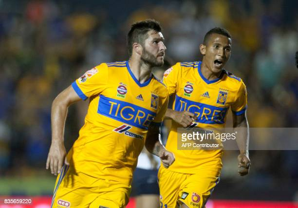 Tigres' Andre Pierre Gignac celebrates after scoring against Pumas during their Mexican Apertura 2017 tournament football match at the Universitario...