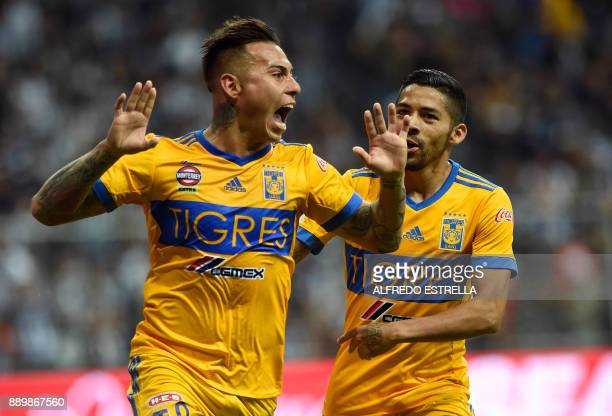 Tigres' Chilean player Eduardo Vargas celebrates his goal against Monterrey with his teammate Javier Aquino during their final Mexican Apertura 2017...