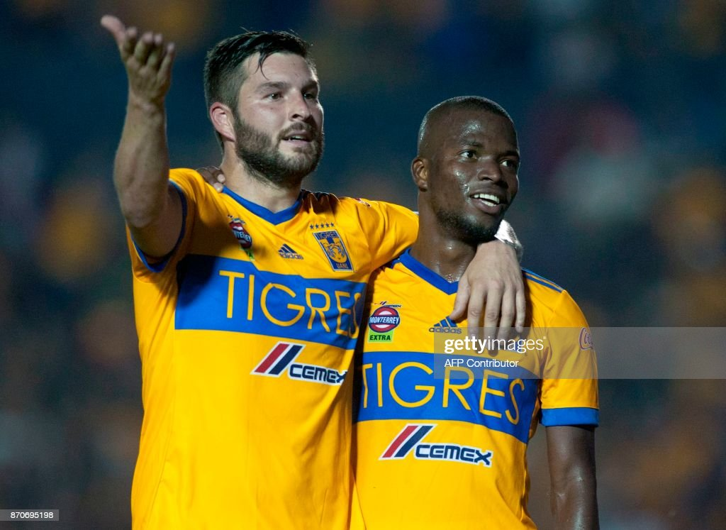 Tigres' Enner Valencia (R) celebrates with his teammate Andre Pierre Gignac after scoring against Necaxa during the 2017 Mexican Apertura tournament football match, at Universitario stadium in Monterrey, Mexico on November 5, 2017. /