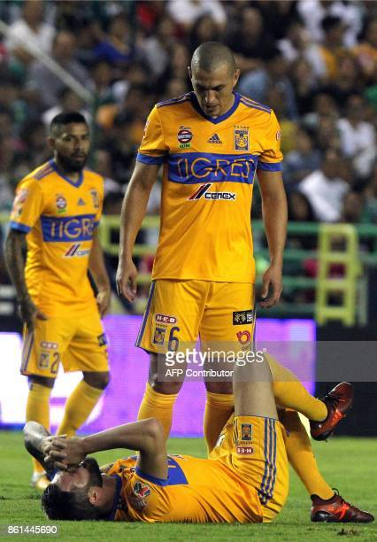 Tigres' French player Andre Gignac gestures on the ground as teammate Jorge Torres Nilo looks at him during the Mexican Apertura football tournament...