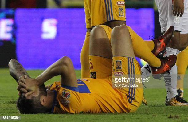 Tigres' French player Andre Gignac gestures on the ground during the Mexican Apertura football tournament match against Leon at the Nou Camp stadium...
