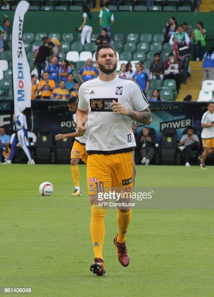 Tigres' French player Andre Gignac warms up before the start of the Mexican Apertura football tournament match against Leon at the Nou Camp stadium...