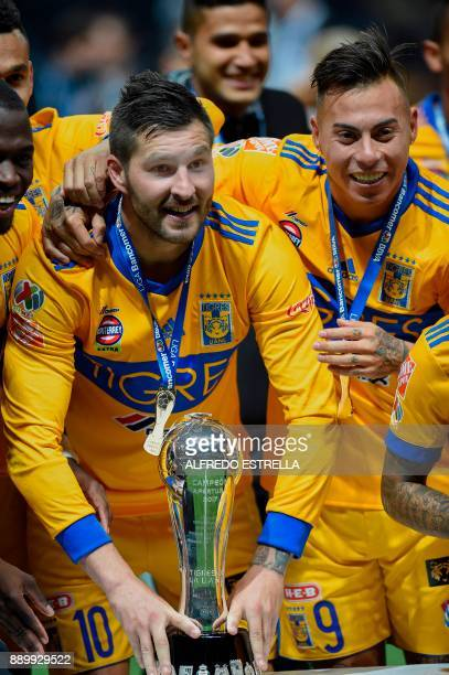 Tigres' French player Andre Pierre Gignac and Chilean player Eduardo Vargas celebrate with the trophy after winning the Mexican Apertura 2017...