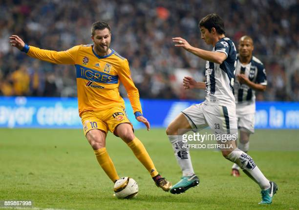 Tigres' French player Andre Pierre Gignac vies for the ball with Monterrey's player Stefan Medina during their final Mexican Apertura 2017 tournament...