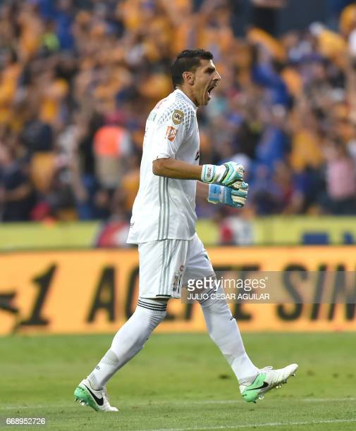Tigres goalkeeper Nahuel Guzman celebrates after his team scores against Pumas during the Mexican Clausura 2017 tournament football match at the...