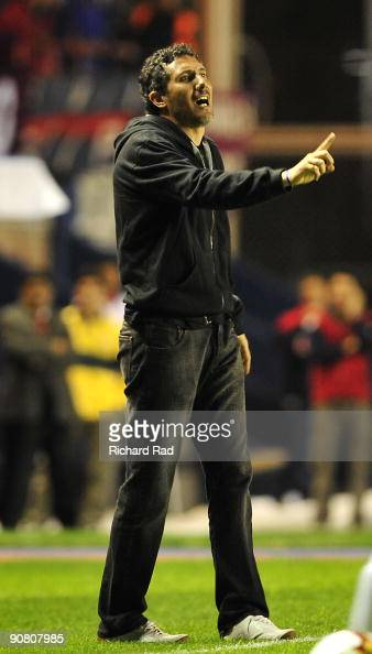 Tigre's head coach Diego Cagna gestures during the match against San Lorenzo for the Copa Nissan Sudamericana 2009 at the Nuevo Gasometro Stadium on...