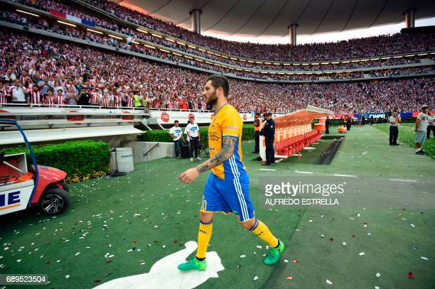 Tigres player AndrePierre Gignac leaves the field refusing to receive the runnerup trophy after losing to Guadalajara during the final match of the...