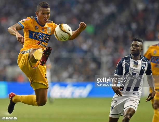 Tigres' player Francisco Mesa jumps for the ball next to Monterrey's player Aviles Hurtado during their final Mexican Apertura 2017 tournament...