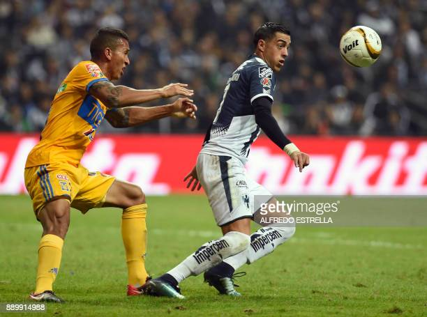 Tigres' player Francisco Meza vies for the ball with Monterrey's player Rogelio Funes during their final Mexican Apertura 2017 tournament football...