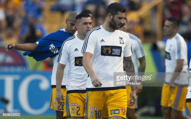 Tigres player French footballer AndrePierre Gignac warms up before the start of their Mexican Apertura 2017 tournament football match against Pumas...