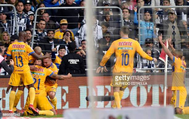Tigres' players celebrate after scoring against Monterrey during their Mexican Apertura 2017 tournament final football match at the BBVA Bancomer...