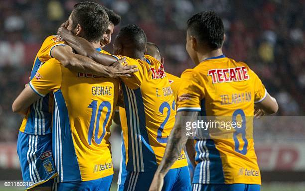 Tigres players celebrate after scoring against Tijuana during their Mexican Apertura 2016 Tournament football match at Caliente Stadium in Tijuana...