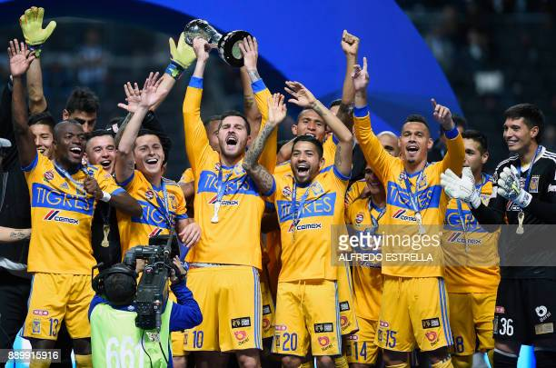 TOPSHOT Tigres players celebrate their victory as they rise the trophy after winning the Mexican Apertura 2017 football tournament final match...